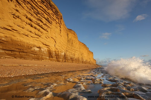 Uk09 672 breaking wave at burton bradstock cliffs dorset 2
